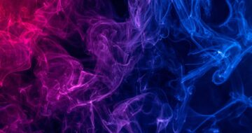Conceptual image of colorful red and blue color smoke isolated on dark black background, Halloween concept design element.